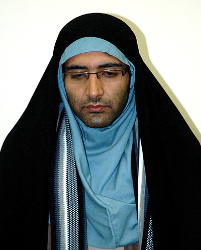 Majid Tavakoli forced into female clothing.