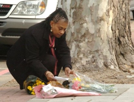 Doreen Lawrence laying flowers at the place where her son was savagely murdered.
