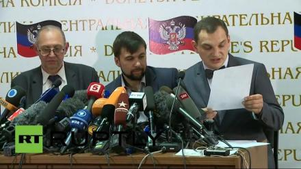 The ponzi-scheme salesman fraudster-cum-governor-elect of Donetsk is the man in the centre, listening to the results of the referendum.