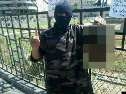 Allegedly Abdel Majid  Abdel Bary, a British Islamic State terrorist, holds the severed head of  victim.