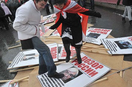 Nashi supporters trample on posters showing opposition images